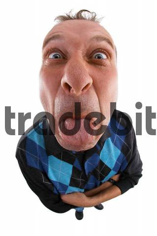A man with outstreched tongue. Photo made with a fisheye-lens.