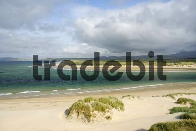 Coastal scenery with sandy beaches and moving clouds at the Atlanic shore of of Co Donegal, Ireland