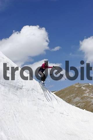 touring skier jumping down snow cornice on mountain Rax Lower Austria Austria