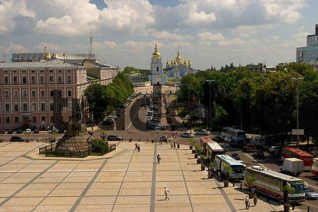 Ukraine Kiev view to Michael monastery 1113 and belltower 1720 old buildings road with cars trees memorial from Bohdan Chmelnyckyj 1657 at Sophien place tourists blue sky and clouds 2004