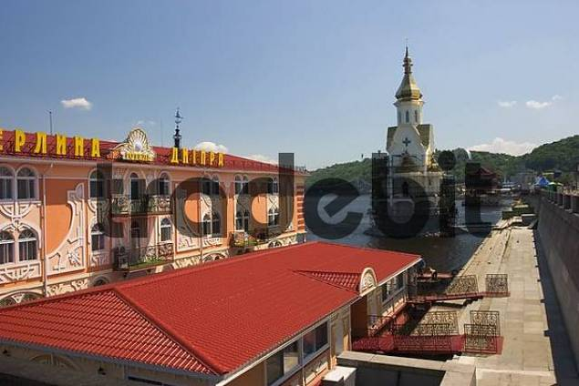 Ukraine Kiev district of Podil at habour hotel ship on the river Dnepr with blue sky and clouds 2004