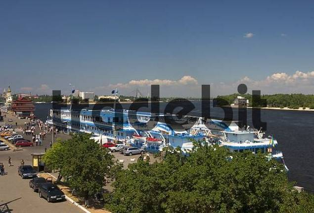 Ukraine Kiev district of Podil tourist - ships at the habour river Dnepr beach at the riverside blue sky 2004