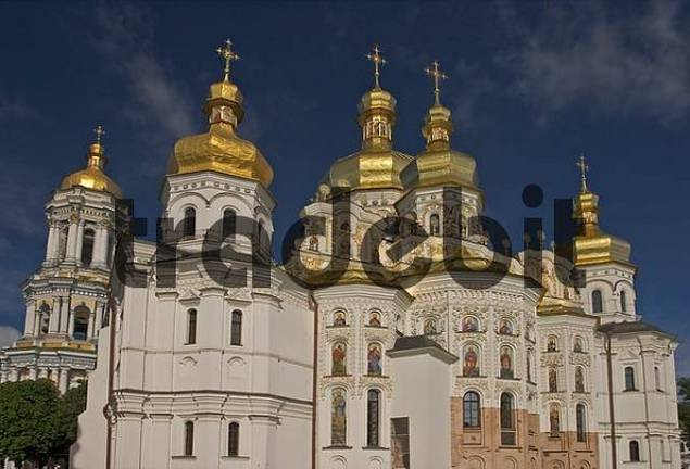 Ukraine Kiev the monastery of cave Kyjevo Pecerska Lavra view to Uspenskyj Cathedral with 7 golden domes and crosses are shining in blue sky 2004