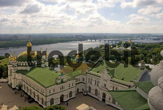 Ukraine Kiev the monastery of cave Kyjevo Pecerska Lavra view to the dome of Refectoriums church with small golden towers green river side view to the city at the river 2004