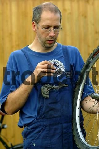 mechanic repairs bicycle
