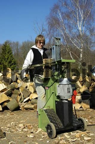 woman splits wood