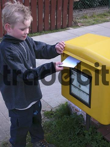 child at the post box