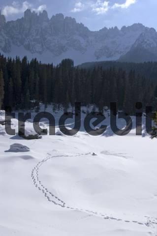 frozen Karersee lake Karer South Tyrol Italy under the Latemar mountains