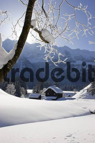 a old wooden house on a creek and a lot of snow Krungl Styria Austria