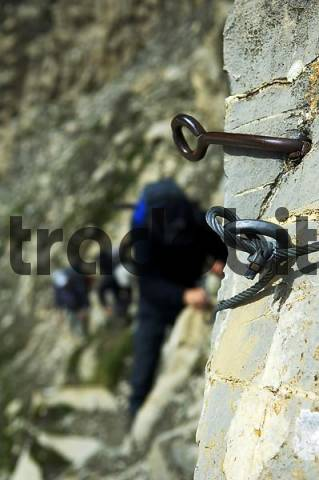 steal hooks fastend in the rock, wire rope, wire cable, mountain climber, mountaineer, alpinist