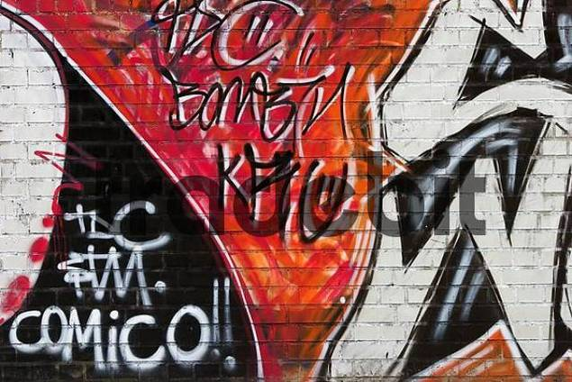 Red, black and white graffiti on a wall in Barcelona Spain.