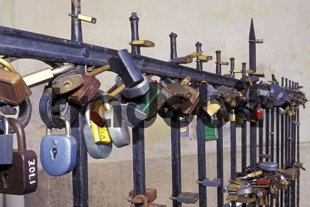 Padlocks as signs of love on a fence in Pecs Hungary