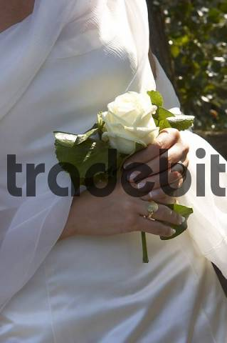 Wedding blossom in hands of the bride