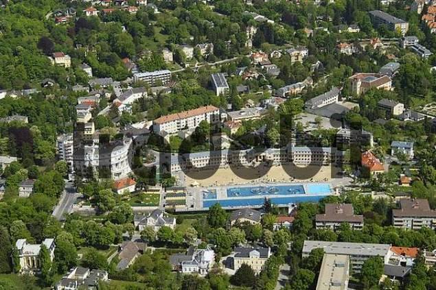 an aerial view of the open air bath which also has a beach Baden Lower Austria