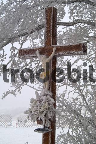 a wooden cross is covered with hoarfrost Lower Austria