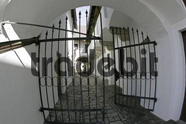 a small alley with an entrance and with ambulatories in the town of Enns Upper Austria