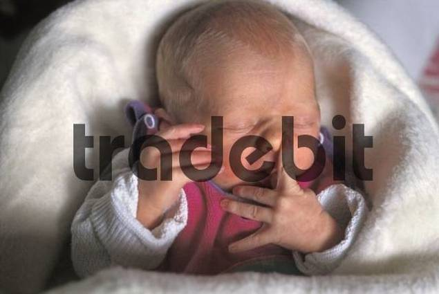 Newborn with finger on the nose MR