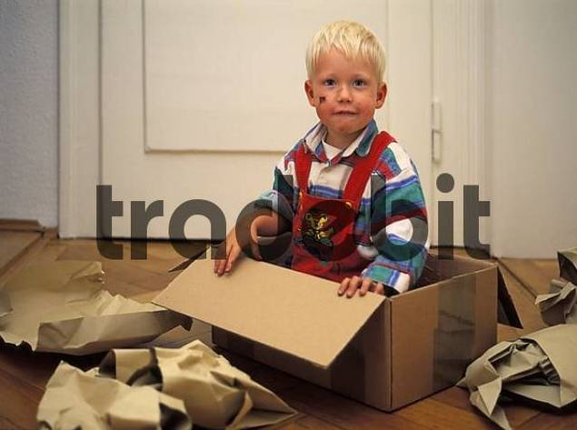 Two-year-old boy in a box MR