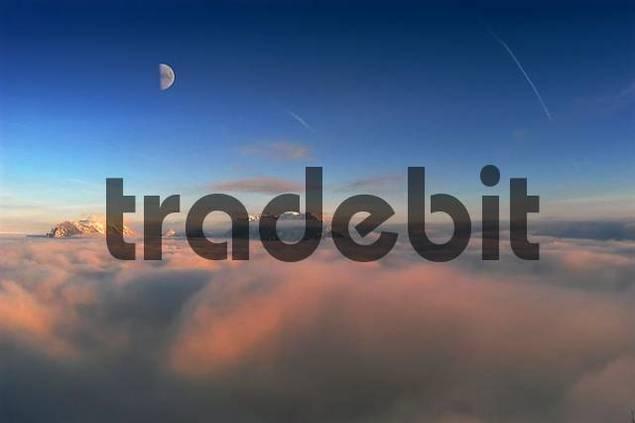 Kaisergebirge and moon above the mist, Tyrol, Austria