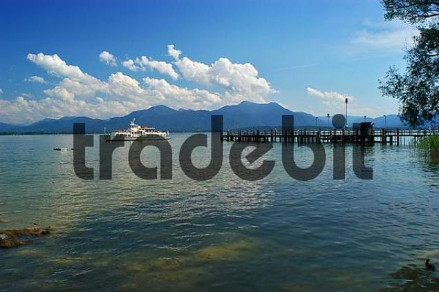 pleasure boat and landing stage, lake Chiemsee, Bavaria, Germany