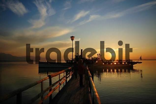pleasure boat at sunset on lake Chiemsee, Bavaria, Germany
