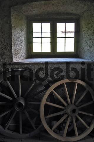 wooden wheels below a window, Upper Bavaria, Bavaria, Germany