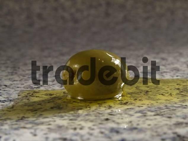 Studio shot olive in olive oil