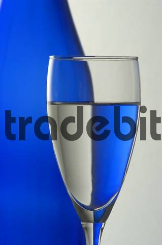 blue bottle and champagne glass, partial view