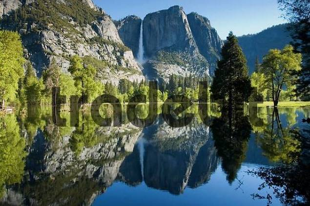 reflection of Yosemite Falls in flooded meadow Yosemite Valley Yosemite National Park California USA