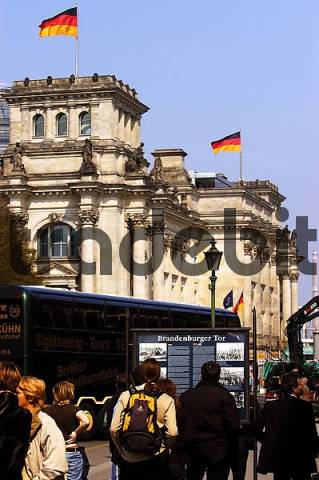 tourists standing in front of an info board at the Reichstag in berlin, germany