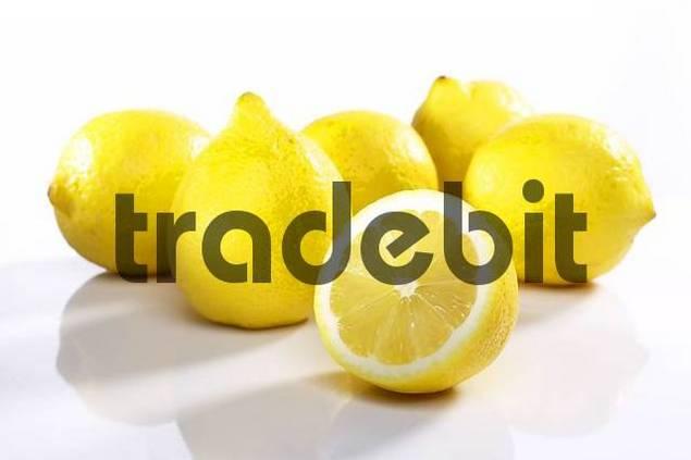 Heap of lemons one cut open