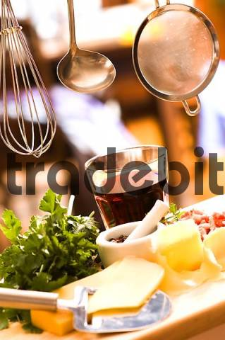 kitchen utensils break with bacon wine cheese