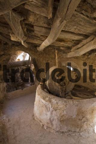 historic olive oil press in the storage castle of Nalut, Nafusah Mountains, Libya