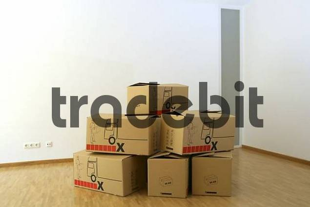 Stacked cardboard boxes, moving