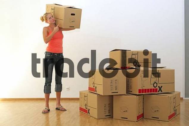 young blonde woman carrying cardboard boxes moving download people. Black Bedroom Furniture Sets. Home Design Ideas