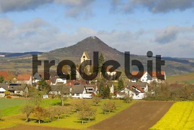The village of Weiterdingen and the volcanic rock hohenhewen - Baden Wuerttemberg, Germany, Europe.