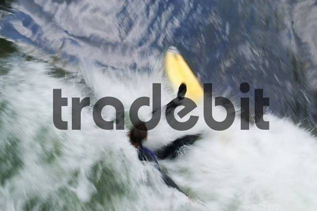Surfer in strong waves