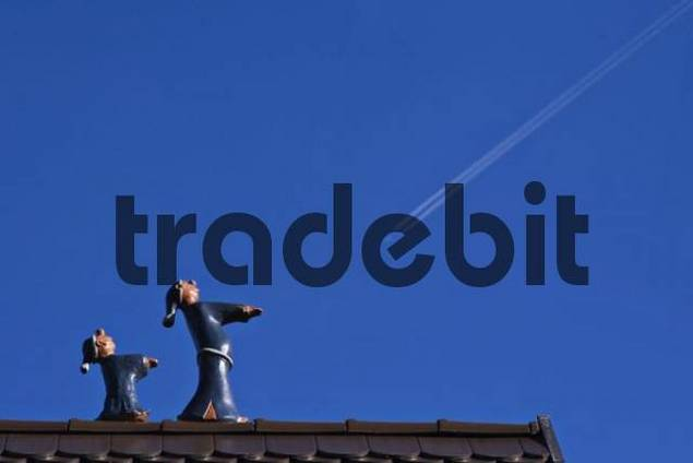 Sleepwalking figures on a roof