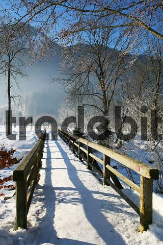 walking bridge with snow
