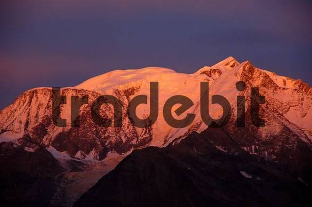 Mt. Blanc mountain glows pink at alpenglow Haute-Savoie France