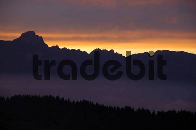 Pink evening sky above a mountain range and forest Haute-Savoie France