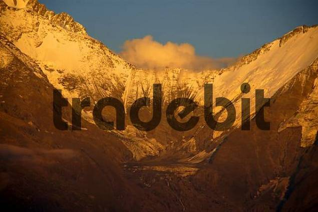 Mt. Blanc mountain with glacier and cloud glows at alpenglow Haute-Savoie France