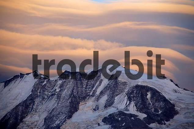 Veils of pink foehn clouds above Mt. Blanc mountain in alpenglow Haute-Savoie France