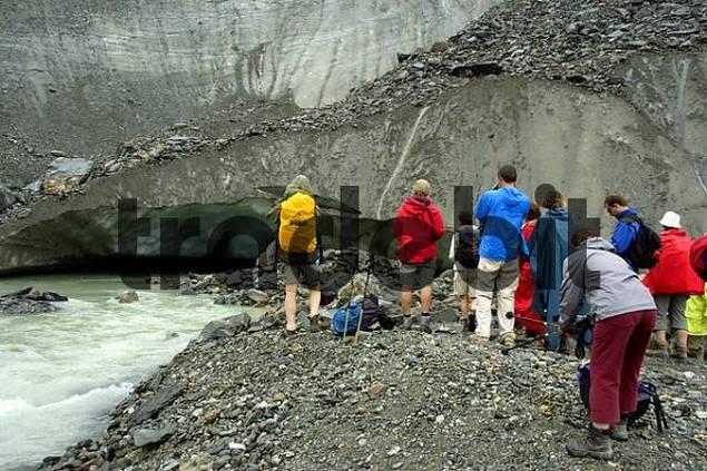 Hiking group at the glacier gate of Glacier de Bionnassay Haute-Savoie France