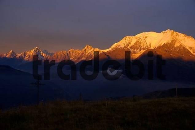 Mt. Blanc mountain glows orange red at alpenglow Haute-Savoie France