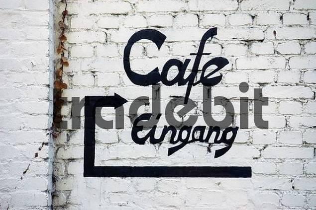 note on a white house wall, cafàentrance, water castle Struenkede, Herne, NRW, Nordrhein Westphalia, Ruhr district, Germany