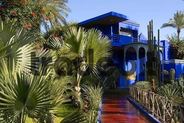 Distinct architectonical feature luminous blue house in garden Jardin Majorelle Marrakech Morocco