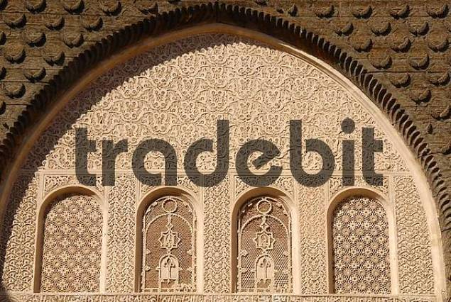 Oriental windows with fine stucco richly decorated Medersa Ali Ben Youssef medina Marrakech Morocco