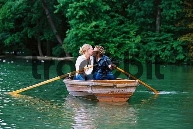 couple in rowing boat kissing