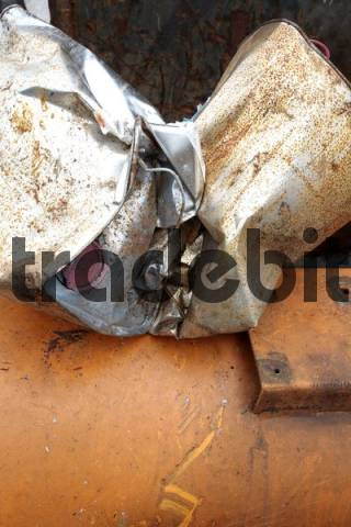 compressed aluminium barrel in the scrapyard